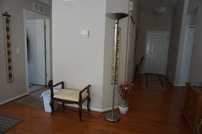 Mahogany stool, floor lamp dimmable, vase of flowers