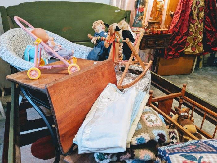 This is in the childs room. Vintage toys and dolls. This is an old school desk.