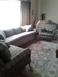 View of sofa and chairs to be sold
