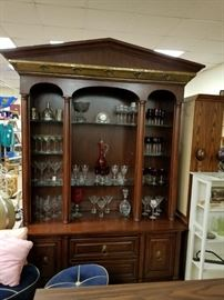 Ornate brass trimmed top cherry stain lighted china cabinet & hutch with glass shelves