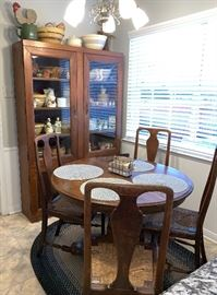 Kitchen table and four chairs Locking Display cabinet