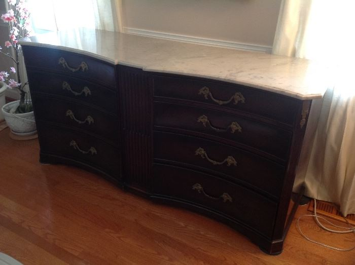 Antique bow front marble top buffet