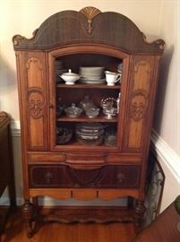 Antique china cabinet.  Original glass front is intact and removed from cabinet.