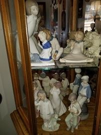 Lladro and other figurines.  Curio cabinet,