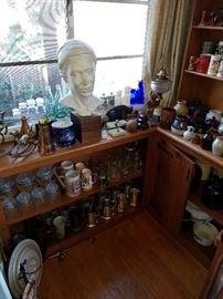 Antique and vintage crocks, steins, tankards, alabaster desk set, oil lamp, water cooler lid, vintage coca cola bottles.