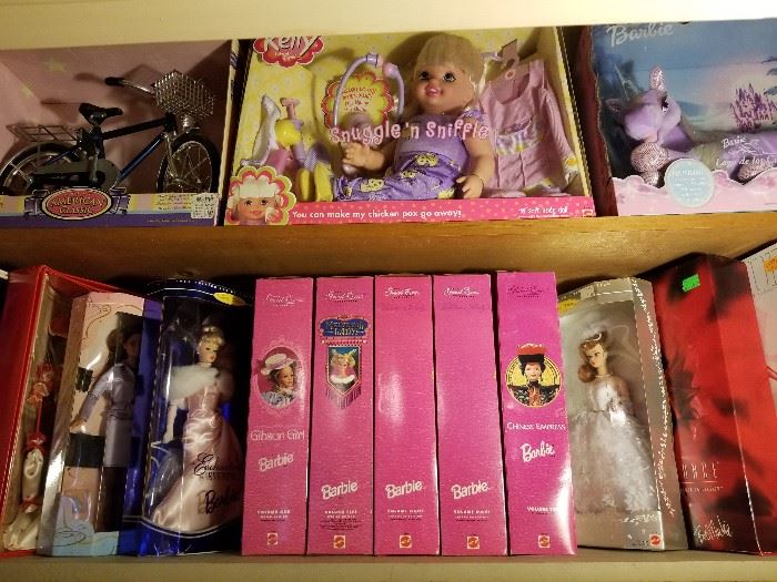Collectible Barbies and  Lila unicorn.