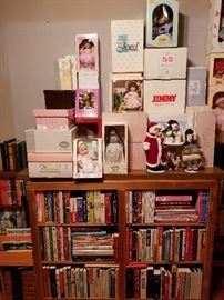 Effanbee, Madame Alexander, Gotz, Georgetown, and Danbury Mint dolls; Raikes Santa bear, cookbooks, Far Side collection, and Bob Ross art book, etc.