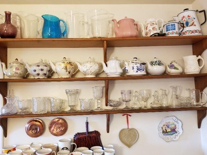 Antique copper lids, vintage teapots, pitchers, and coffee pots, vintage EAPG glass.