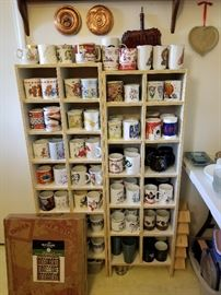 Antique copper lids and dust pan, spice racks (no spices), and mugs.
