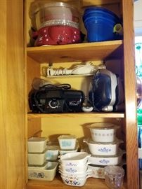 Pyrex and vintage glass refrigerator boxes, Corning casserole dishes, and small kitchen appliances