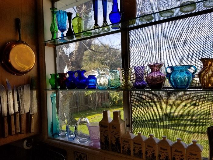 Fenton and other glass vases, vintage blue delft oil, vinegar and spice bottles from Germany.