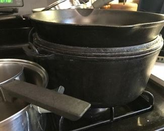 Cast iron and a cast iron dutch oven ....nab this one fast!