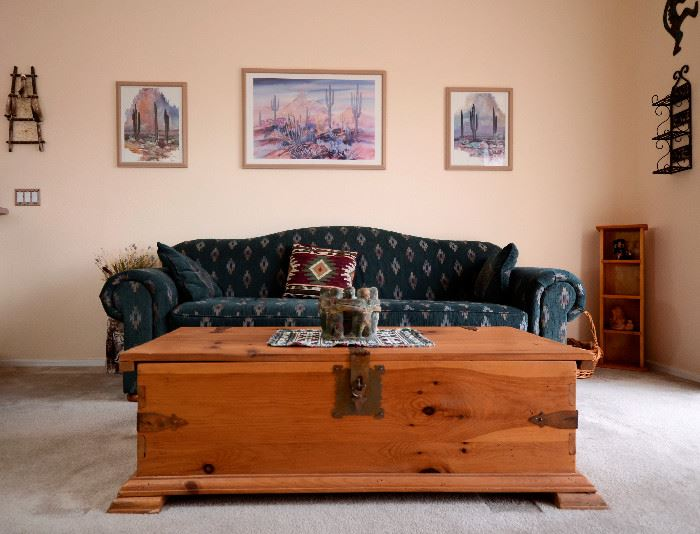 Fabulous wooden trunk used for a coffee table here.