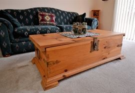 All wood trunk that opens for storage. Great coffee table or storage trunk at the end of a bed. Beautiful condition as with everything in this immaculate home.
