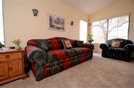 This is the sleeper sofa for sale and there is also  a regular sofa for sale. Like new southwest patterned sofas.