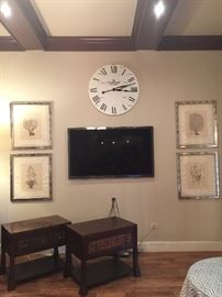 Art work and wall clock.  TV is not for sale