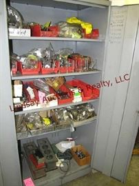52 - Contents of cabinet: automotive parts, valves,  13 Image(s) gears, springs, nuts, bolts, 2 - cyl blocks & other misc (NO CABINET)