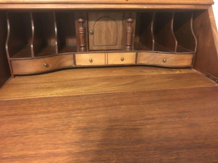 Inside of serpentine front writing desk