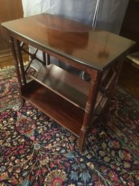 Antique mahogany end table with book rack
