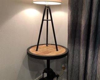 pair of these industrial height-adjustable tables as well as tripod lamps