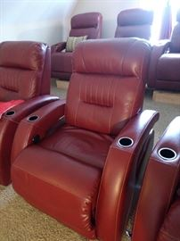 HOLY COW!!  These electric theatre chairs are awesome!!  With the puck of a button it will will recline you all the way back!!