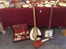 Unusual banjos. And a ukulele and silver plate serving set.