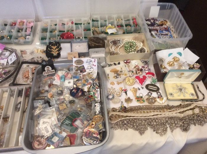 Tables of jewelry. Collectibles pins