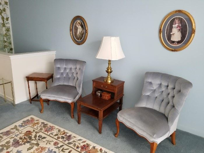 Two classic tufted armless chairs, side tables