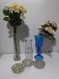 Flower frogs, vases and some roses