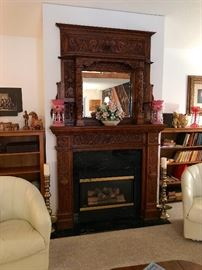 "Heavy Carved Antique Fireplace Mantel Dimensions: 8'3"" Tall x 5' Wide, Opening 3' 2"" Square, Mirror 28"" Wide by 24"" Tall."