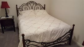 Queen bed set, w/nightstand. Down comforter with duvet & shams. Bedding sold sep.