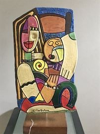 Clay figure - handpainted and signed - hanging on a stand - very contemporary