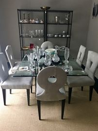 Outstanding dining table - glass with black iron base.  Chairs are covered in suede and each has a slightly different shape in the back.