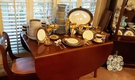"""Mahogany Duncan Phyfe Style Drop Leaf Dining Table with Two Leaves and Custom Pad.  Set of six Mahogany Dining Chairs, Eighty Piece Seyei """"Anniversary"""" China Service for Twelve with Serving Pieces, Gold Trimmed Turkish Glassware..."""