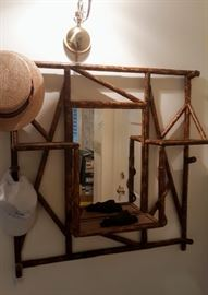 Fabulous bamboo wall hung etagere with mirror.