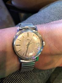 Glycine wrist watch           Omega men's wristwatch.       Pulsar moon face wrist watch
