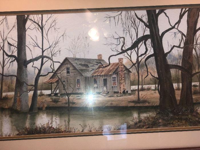 Original watercolor pencil framed cabin bayou scene.