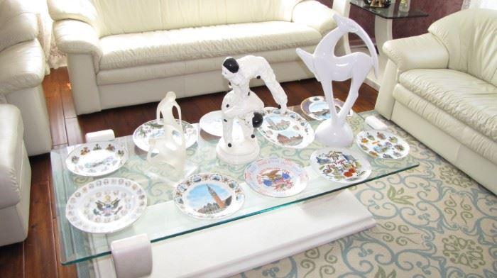 Collectible plates, sculptures, vintage table.