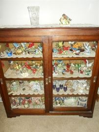 Antique sliding door cabinet and LOTS of bird figurines