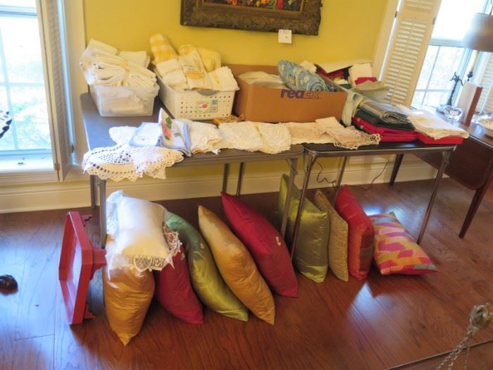 lots and lots of linens, napkins, pillows, placemats, crochet
