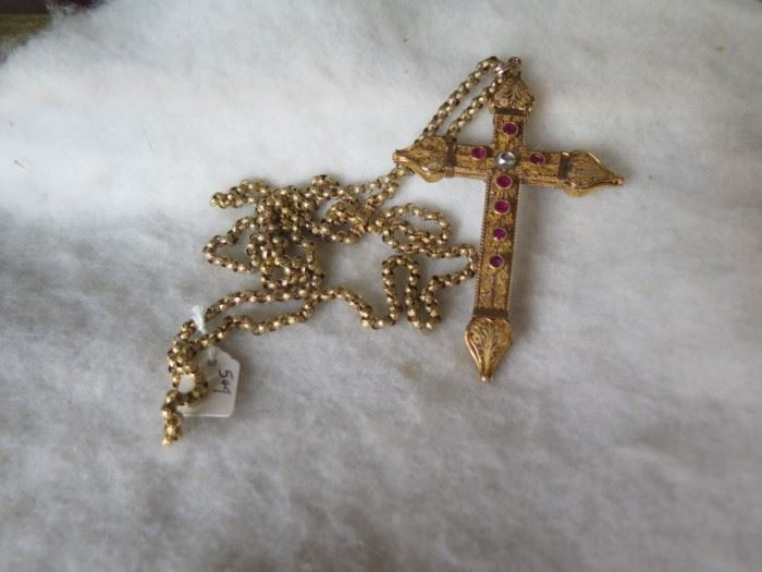 gold cross with diamond and rubies