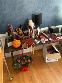 Holiday decorations, garage tools and hardware, miscellaneous items, lamps, storage boxes.