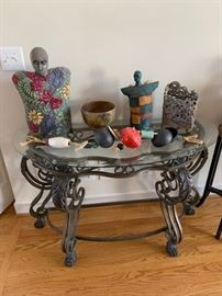Glass top iron hutch, eclectic artwork including rare stone sculptures.
