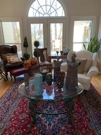 Beautiful traditional leather furniture, double sided signed Persian rugs, multiple glass top and wooden coffee tables, artwork and pottery, stonework sculptures, indoor plants and more.
