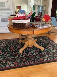 Beautiful vintage wooden circular kitchen table.  Miscellaneous decor and storage items.  Kitchen rug.