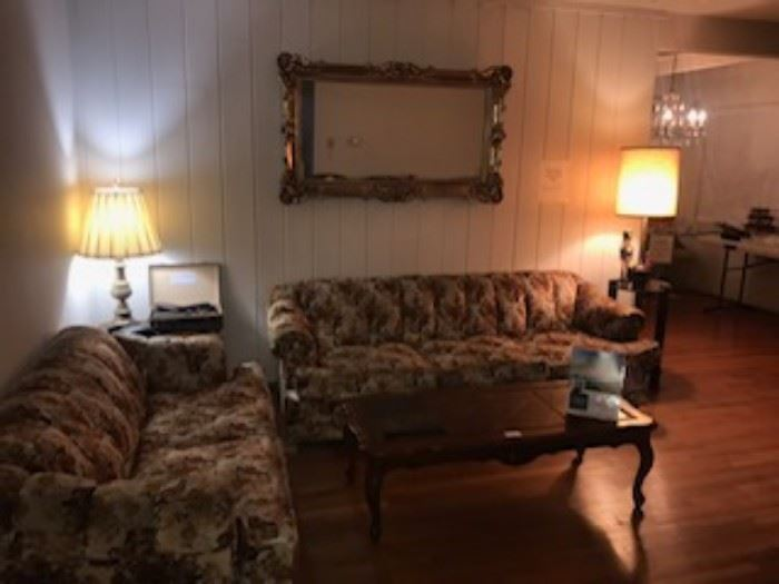 Couches, end tables, coffee table, lamps, mirrors