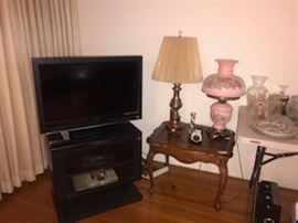 TV and tv stand, lamps, end tables, cameras, Vintage Projector from 1950s