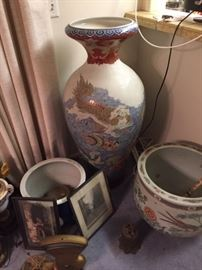 In the center is the tall decorative, oriental-style vase, about 4 feet tall.  There are other decorative planters available as well.