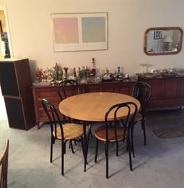 In this photo, a dining room table and chairs is shown, as well as a buffet and server cabinets.