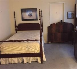 Two full-sized bedframes are shown here.  The left is a four-poster style, while the right is just the headboard and footboard.